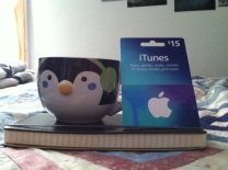 A new journal, penguin mug, and music card