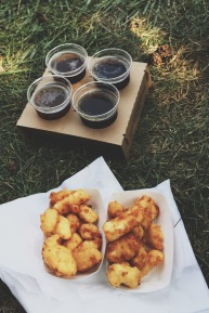 Flight of craft beer and deep fried cheese curds