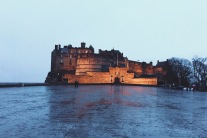 Edinburgh Castle at twilight in the rain.