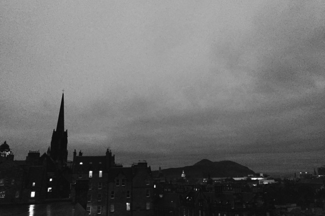 Edinburgh skyline, featuring Arthur's Seat, at twilight.
