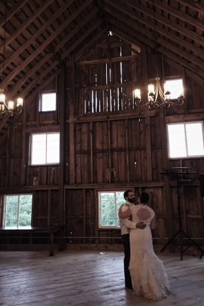 The bride and groom share their first dance as Mr. and Mrs.